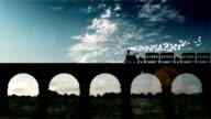 steam train runs on a railway bridge video