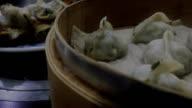 Steamed dumplings in a steamer video