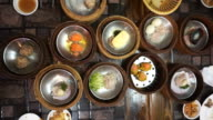 Steaming Dim Sum eating, top view point of variety traditional Chinese food video