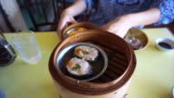 Steaming Dim Sum open in different layers traditional Chinese food video