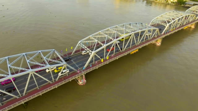 Steel Bridge across River at Morning with Golden Sky. Aerial shot video