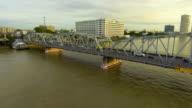 Steel Bridge across River at Morning with Golden Sky. video