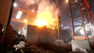 Steel making factory with fire and smoke video