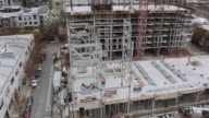 Steel structure being hammered in place on construction site video