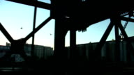 Steel truss bridge, river industry driving shot video