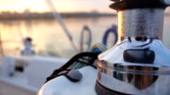Steel winch without rope on sailing boat. Dynamic change of focus. Close up video
