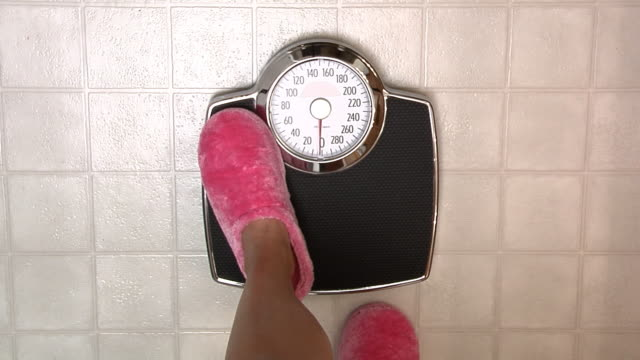 Stepping onto a scale video