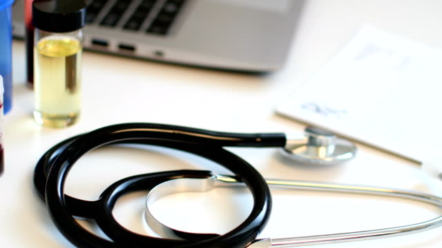 Stethoscope and prescription pad on Doctor's desk video
