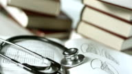 HD: Stethoscope Lying On Medical Books video