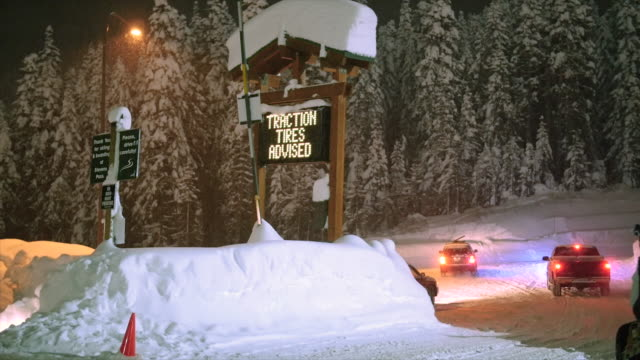 Stevens Pass, WA 12-27-15: Snow Covered Parking Lot with Skiers and Snowboarder video