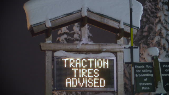 Stevens Pass, WA 12-27-15: Traction Tires Advised Sign Flashing on Snowy Night video