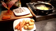 Stew meat preparation with potatoes and carrots video