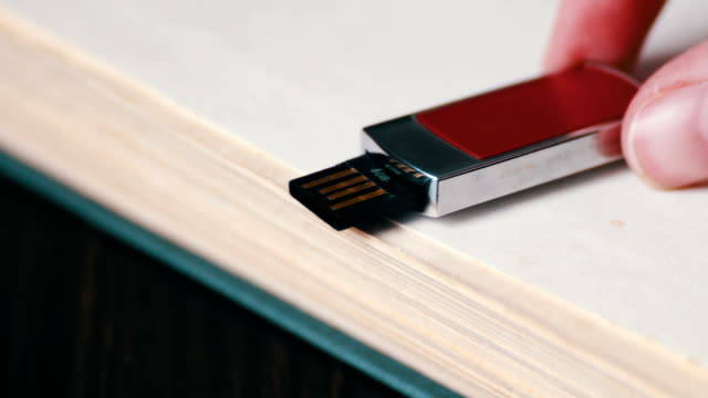 USB stick and New Book pages macro video