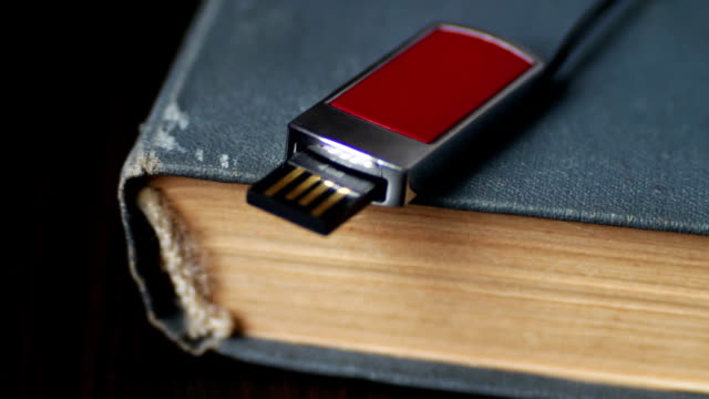 USB stick and old vintage Book pages macro video