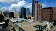 Still Aerial Video high above Austin Texas Downtown Frost Bank Tower and Traffic driving around City Hall video