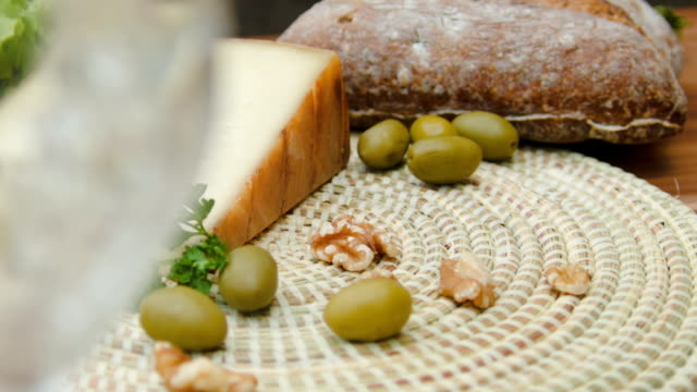 Still life of bread, olives and nuts, tomme cheese video