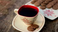still life of teapot, bowl, cookies on a white plate with ornament video
