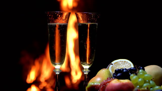 still life with champagne on the background of fire video