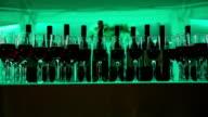 Still life with wine bottles, glasses and oak barrels. video