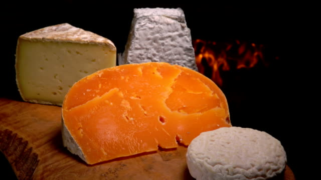 Still-life French of cheese on a wooden board video