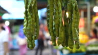 Stink bean, Sato bean or Parkia speciosa seed hanging in This market video
