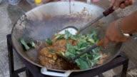 Stir fried rice noodle in pan (Korat stir fried noodle, Thailand food) video
