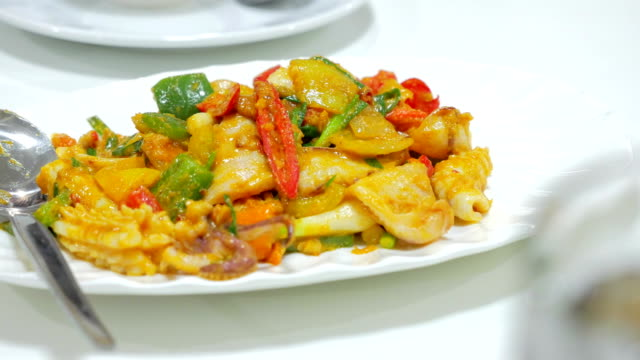 stir fried squid with curry powder and egg, Thai Traditional Cuisine. video
