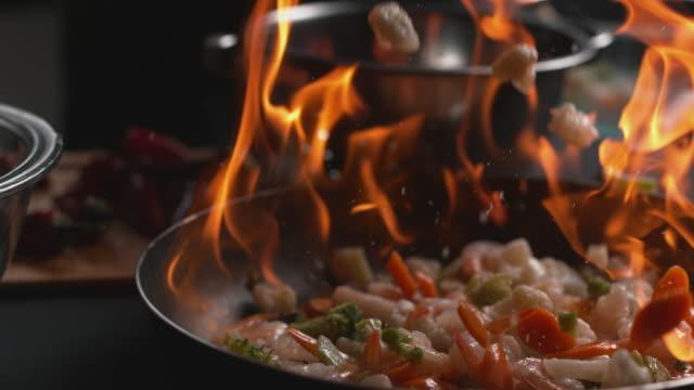 Stir fry into flaming pan video