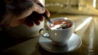 Stir in a cup of tea with a spoon video
