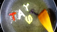 Stir-frying mixed alphabet letters, word Tasty video