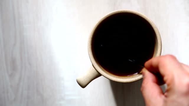 Stirring black coffee video