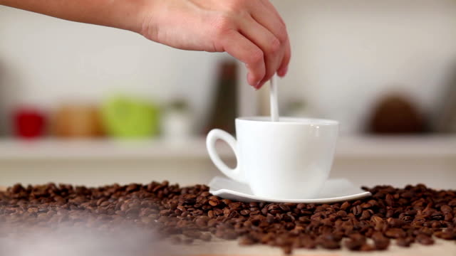 Stirring in a cup of coffee video