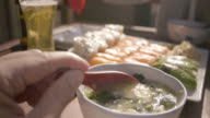 Stirring Miso Soup at Sushi Dinner video