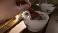Stirring Miso Soup on a Dinner Table video