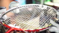 4K Stock footage of Man made weaving badminton racket, by auto machine video
