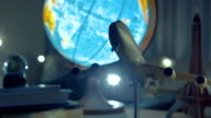 Stock video footage. Toy aircraft with globe and Eiffel Tower on the table. Traveling. Adventures. Holidays. video