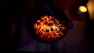 Stoking Fire with Charcoal on a BBQ Barbecue Grill by night video