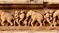 Stone carving bas relief, Lakshmana Temple, Khajuraho, India video