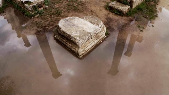 Stone hart reflections of columns in water ruins ancient town Salamis east Cyprus Famagusta video