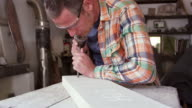 Stone Mason At Work On Carving In Studio Shot On RED Camera video