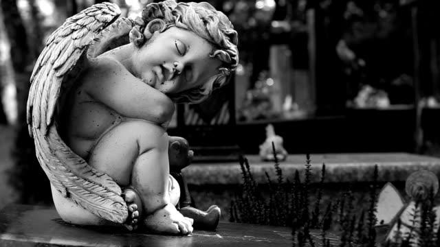 Stone statue of the cherub in the cementery video