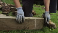 Stone Worker Using Striking Chisel video