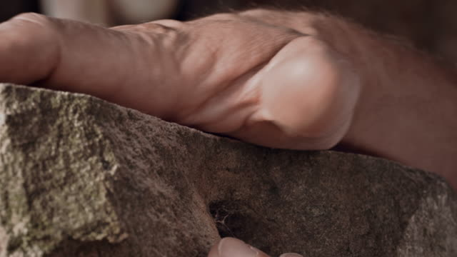 Stonemason caressing stone video