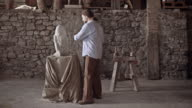 Stonemason starts carving stone with hammer and chisel video