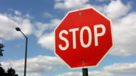 Stop sign. Timelapse clouds. video