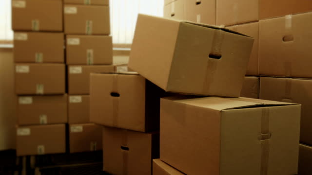 Storage room with heap of pasteboard boxes video