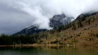 Storm Clouds Covering Mountain Tops and Lake video