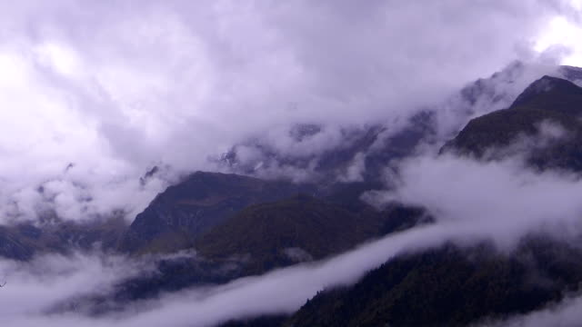 Storm clouds moving among the mountain peaks. video