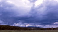 Storm clouds passing over horizon of Colorado landscape, dusk to dark time lapse video