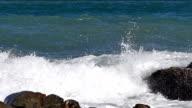 Stormy sea waves on rocky beach near Phuket Thailand, Slow motion, close up. video